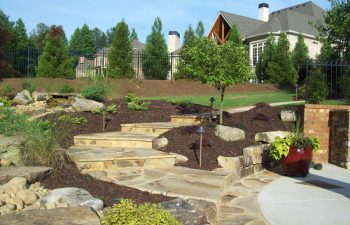 garden flagstone patio and walkway by Mobile Joe's Landscaping