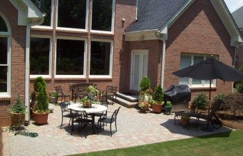 house with garden paver patio