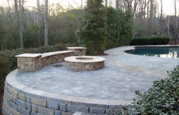 backyard stone patio with fire pit