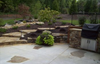 backyard with patio and walkway designed by Mobile Joe's Landscaping