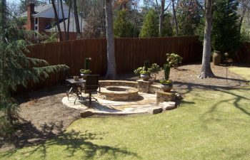 garden flagstone patio with a fire pit