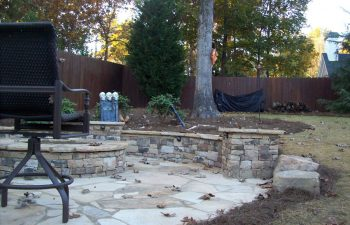 fall ggarden flagstone patio with a fire pit