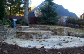 fall garden flagstone patio with a fire pit