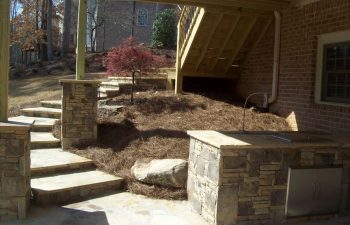 flagstone deck steps and outdoor kitchen