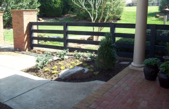 paved porch and concrete walkway