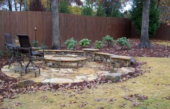 fall flagstone patio with a fire pit