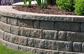 A stone rtaining wall in the garden